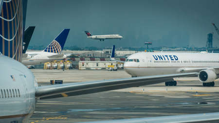 June 17, 2017: Newark International Airport, New Jersey US-airplanes, parked moving and taking off at airport Editorial