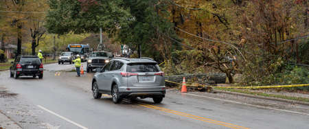 Carrboro, North Carolina, US-November 13, 2018: Workers repairing power lines after tree fell on them in storm Editorial