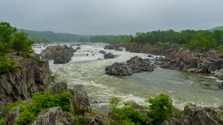 Rushing water at Great Falls National Park on a stormy overcast day