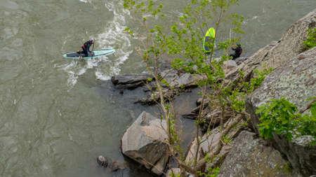 Two Men on Kayaks paddling on the river at Great Falls National Park, Va.
