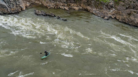 Men on Kayak paddling on the river at Great Falls National Park, Va.