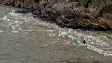 Man on Kayak in wetsuit on kayak on the river at Great Falls National Park, Virginia