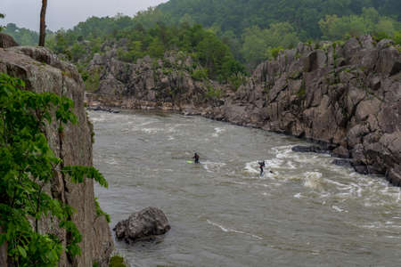 Two men on Kayaks paddlying on the river at Great Falls National Park, Virginia Reklamní fotografie