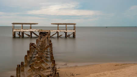 Dilapidated old fishing dock collapsing into the sea in Pak Nam Pran on the Gulf of Thailand in Thailand