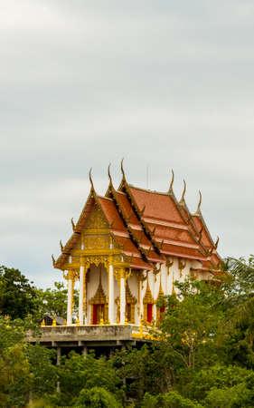 Thai temple rising about the trees in Pak Nam Pran, Pranburi Thailand Reklamní fotografie