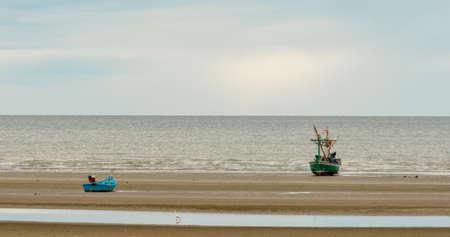 Traditional Thai ishing boats at the beach in Pak Nam Pram, Thailand Stock Photo