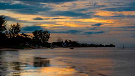 Reflection of coastline of Pak Nam Pran at dusk in Thailand just after sunset