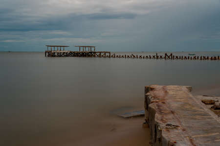 Dilapidated old fishing dock collapsing into the sea in Pak Nam Pran on the Gulf of Thailand in Thailand Reklamní fotografie
