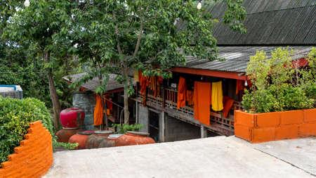 Monk robes hanging on lines outside their rooms in Wat in Pak Nam Pran, Pranburi Thailand Reklamní fotografie