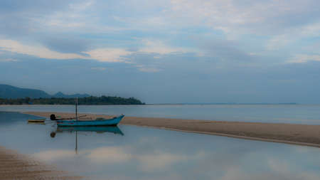 Small fishing boat and dingy sitting in tidal pool at low tide at Pytium on the Gulf of Thailand Imagens