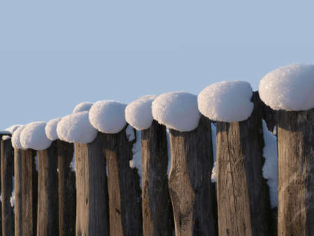 parallelism: Tops of plates ������ are covered by snow. The impression of the constructed rank of people is made.