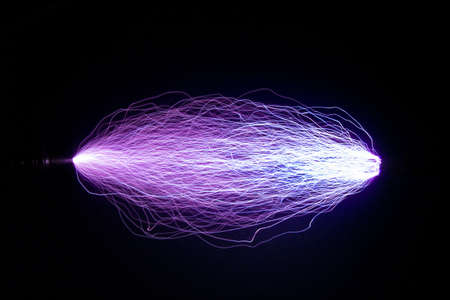The trajectory of a spark electric discharge.This Spark discharge created in the air. Is used to observe the phenomenon.