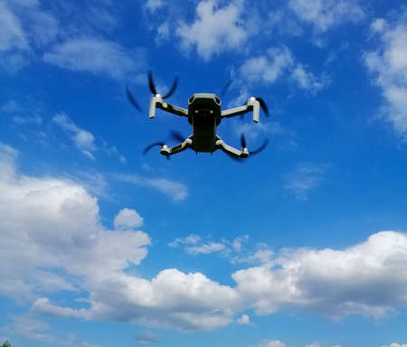 Quadcopter flight. The quadcopter performs a controlled flight over a specific area. Standard-Bild - 151513122