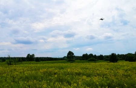 Aerial photography of the landscape by a quadrocopter camera. The quadcopter performs a controlled flight over a specific area. Standard-Bild