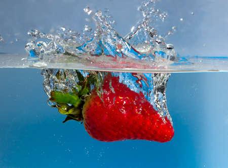 Strawberry splash with blue background