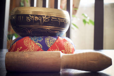Closeup of a tibetan bell on a table