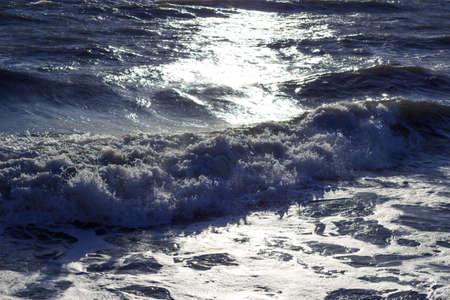 livorno: Rough sea waves in sunlight