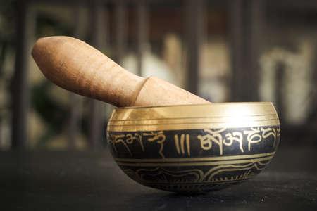 Closeup of a tibetan bell on a table