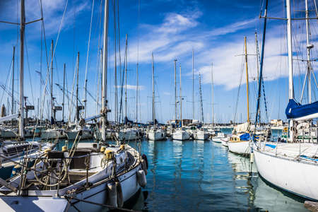 livorno: Small boats at the pier in a summer day in Livorno, Tuscany, Italy. Stock Photo