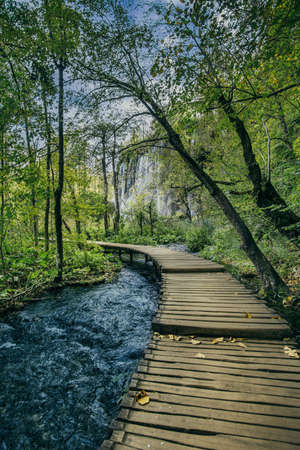 Wooden walking path over turquoise water in Plitvice Lakes National Park, Croatia, Europe