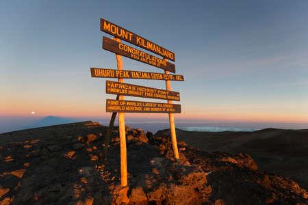 at the highest: Uhuru Peak highest summit on Mount Kilimanjaro in Tanzania, Africa.