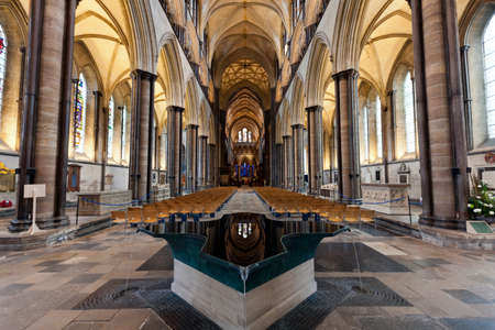 nave: Salisbury Cathedrals beautiful Baptismal Font and Nave. England.