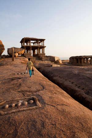 karnataka culture: Sunset on Hemakuta Hill, Hampi, Karnataka in India Stock Photo