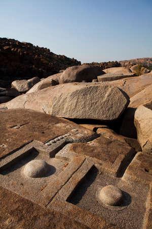 linga: Linga carved into the rock on the bank of the Tungabhadra River, Hampi, Karnataka, India. Stock Photo