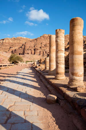 colonnaded: The Colonnaded street of Petra against ancient Nabataean tombs - Jordan