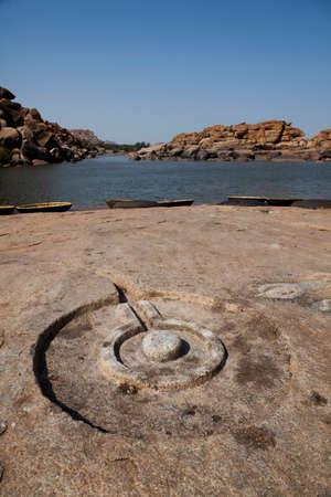 linga: Shiva linga carved into the bank of the Tungabhadra River, Hampi. India. Stock Photo