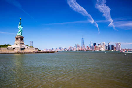 The Statue of Liberty and Manhattan skyline in New York City, America.