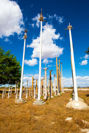 An animist ritual place near Loikaw, Myanmar. The place is used to put some of the harvest beneath the poles as a thanksgiving to the gods. Stock Photo