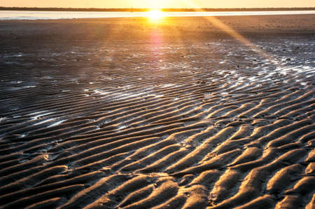 furrows: Furrows in the beach with a sunset in the background