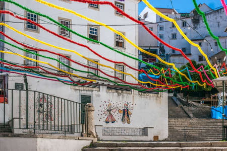 adorned: Stairs of San Miguel in Alfama neighborhood, adorned With many colors During the holidays of San Antonio, Lisbon