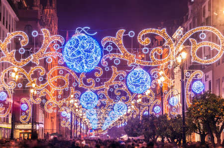 Night view of the main avenue of Seville illuminated with lights for Christmas