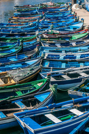 Fishermens blue traditional boats in the fishing port of Setubal, Portugal