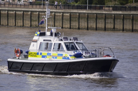 patrolling: London, 8 August, 2012-Police boat patrolling on the river Thames, during the 2012 London Olympics