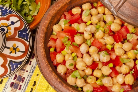 Delicious tangine of chickpeas and tomato salad