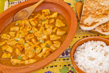 curry chicken: Delicious casserole of chicken curry with rice and cardamon and pitta bread Stock Photo