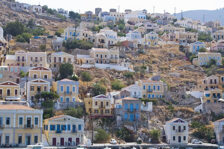 View of some houses on a hill in the village of Symi near Rhodes, Greece