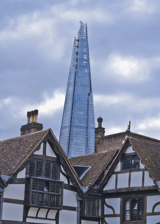 View of The Shard from the Tower of London with a cloudy sky Stock Photo