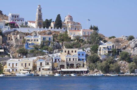 Traditional houses in the town of Symi near Rhodes, Greece Stock Photo
