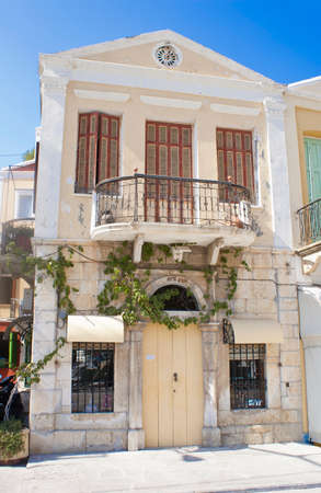 Facade of a traditional house in the town of Symi near Rhodes, Greece Editorial