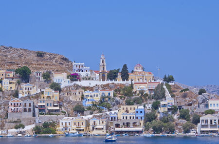 View of some boats and houses in the village of Symi near Rhodes, Greece