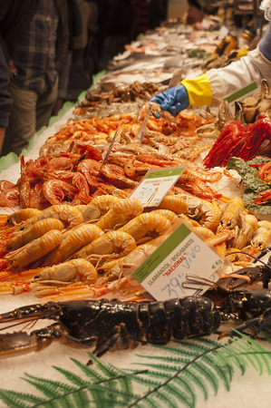 fishmonger: Fishmonger stall in an indoor market with fresh seafood and fish Stock Photo