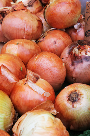 Background of onions in a market Stock Photo
