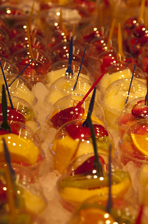 Close up of fresh fruit salad cups to go in a market stall