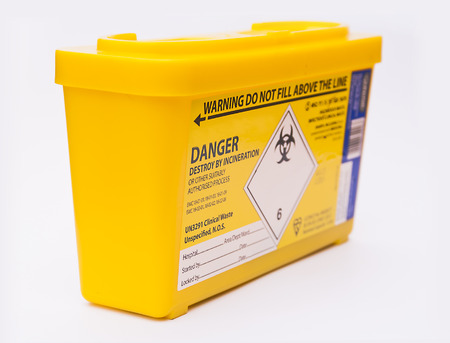 medical syringe: Medical or clinical sharps yellow waste container