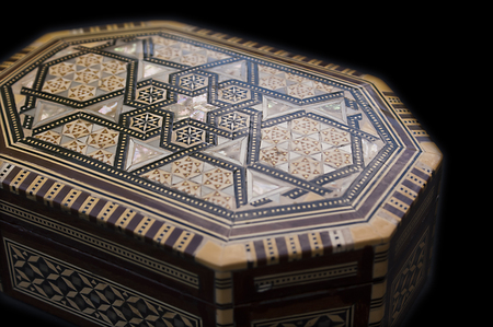 Beautiful mother of pearl box on a black background