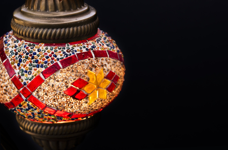Turkish lamp on a black background with copy space